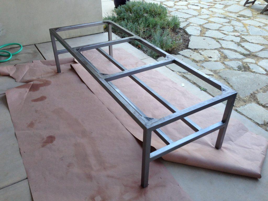 Walnut, custom steel frame, caster wheels, dining table